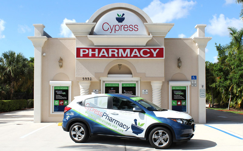 Cypress Pharmacy car in front of the store